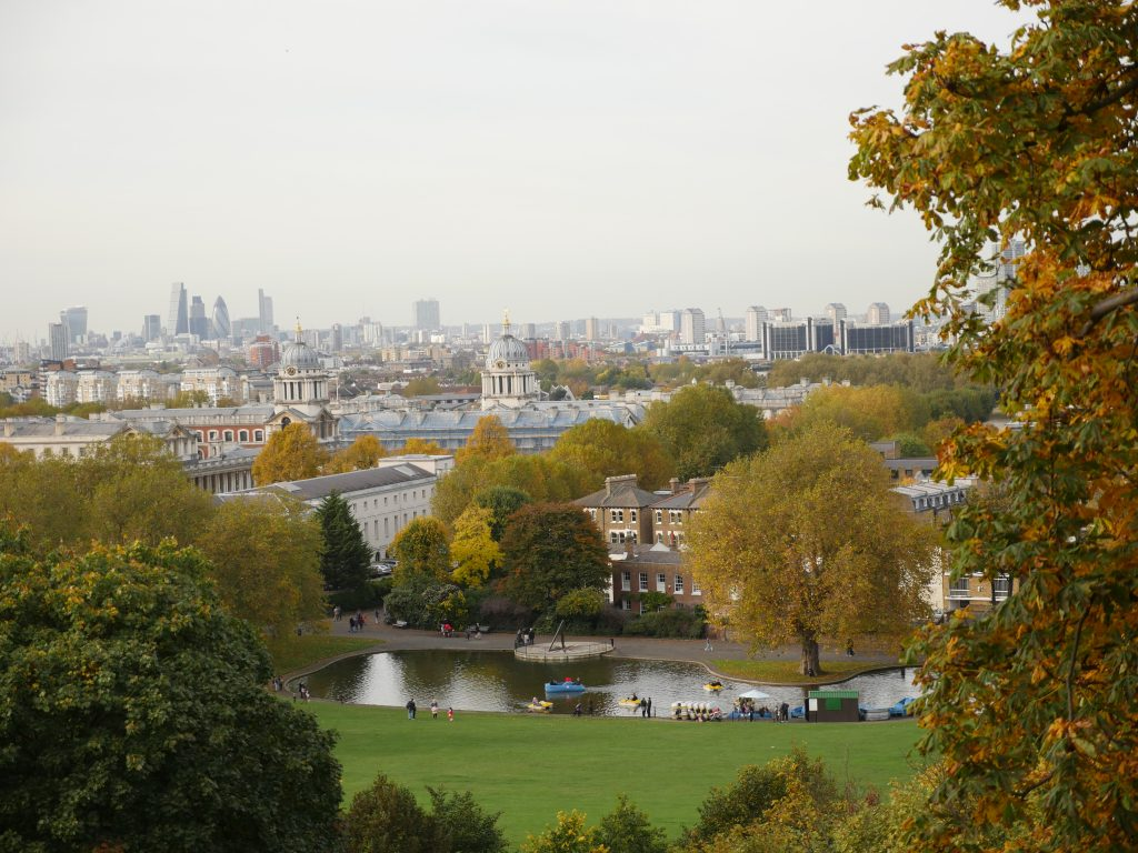 A view of London from the top of Greenwich park overlooking the city of London and the Maritime museum