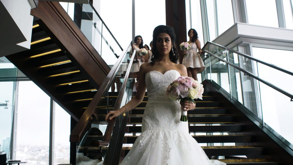 Luxury Wedding Film bride walks down the stairs