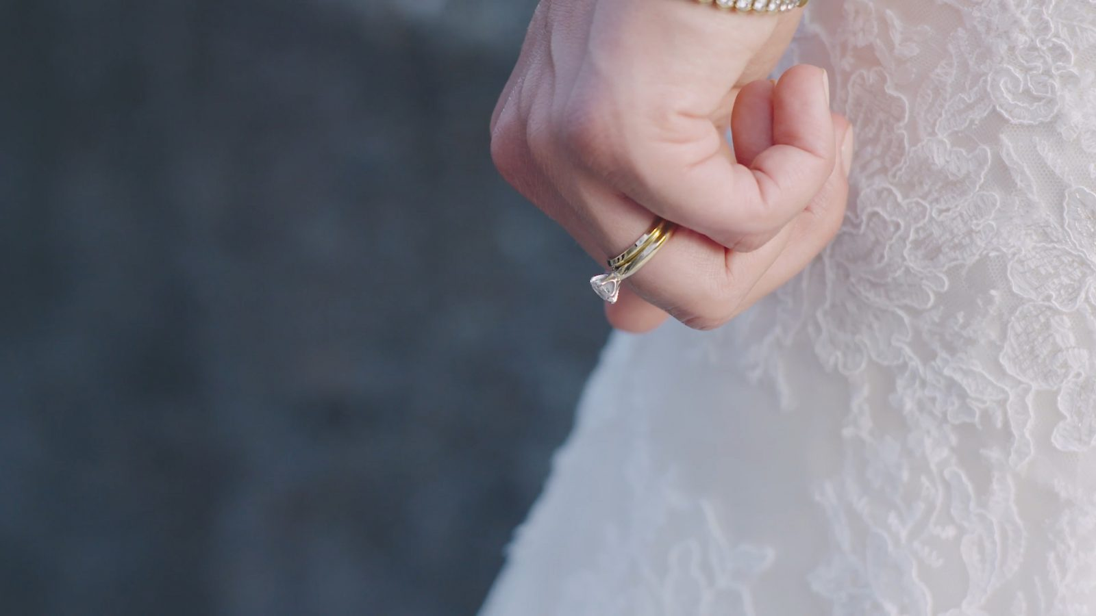 A wedding ring on a brides hand